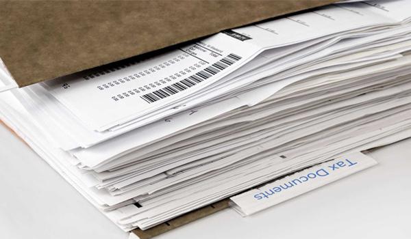Cách thức lưu trữ hóa đơn giấy thủ công, tốn nhiều thời gian.